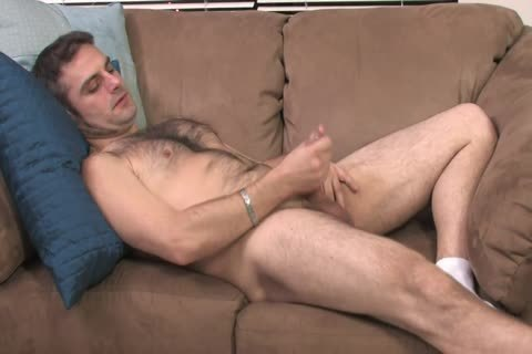 bushy chap Lays On The sofa And Starts Playing With His Hard Pole